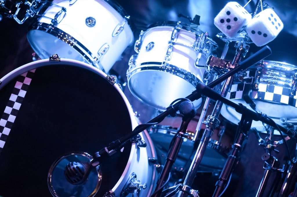 drumkit on stage under blue spotlights